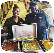 Small business owners Candace Maiden and Kurtis Williams stand at a Squash the Beef catering event