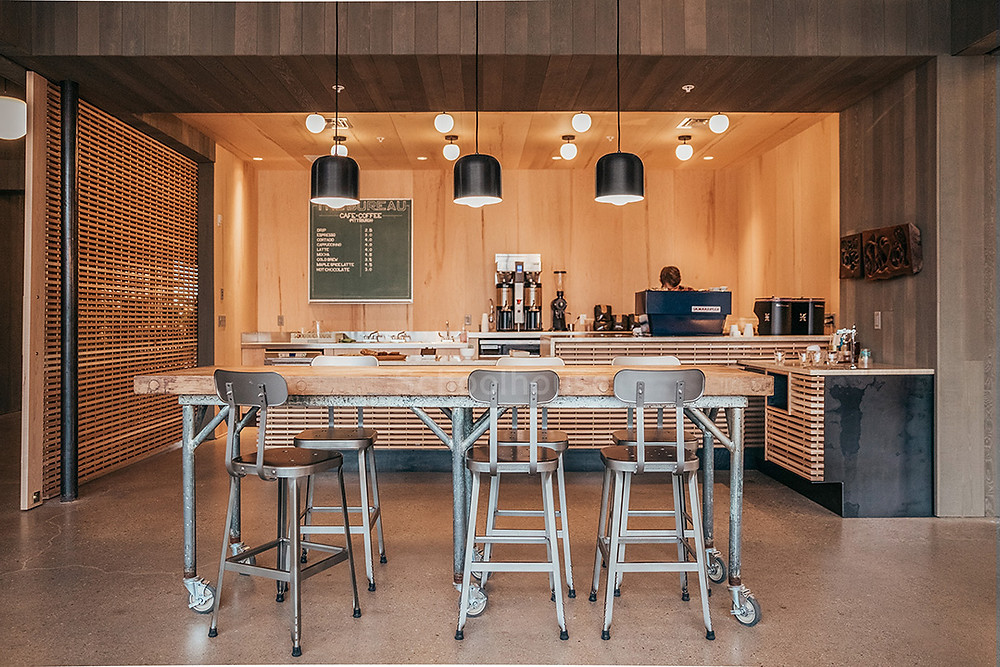 An overlook of the seating, lighting, and bar area at The Bureau Coffee, designed by mossArchitects