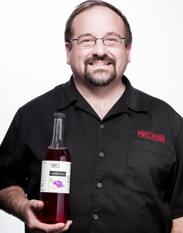 Clark, owner of Pope's Kitchen, with a bottle of lavender lemon simple syrup