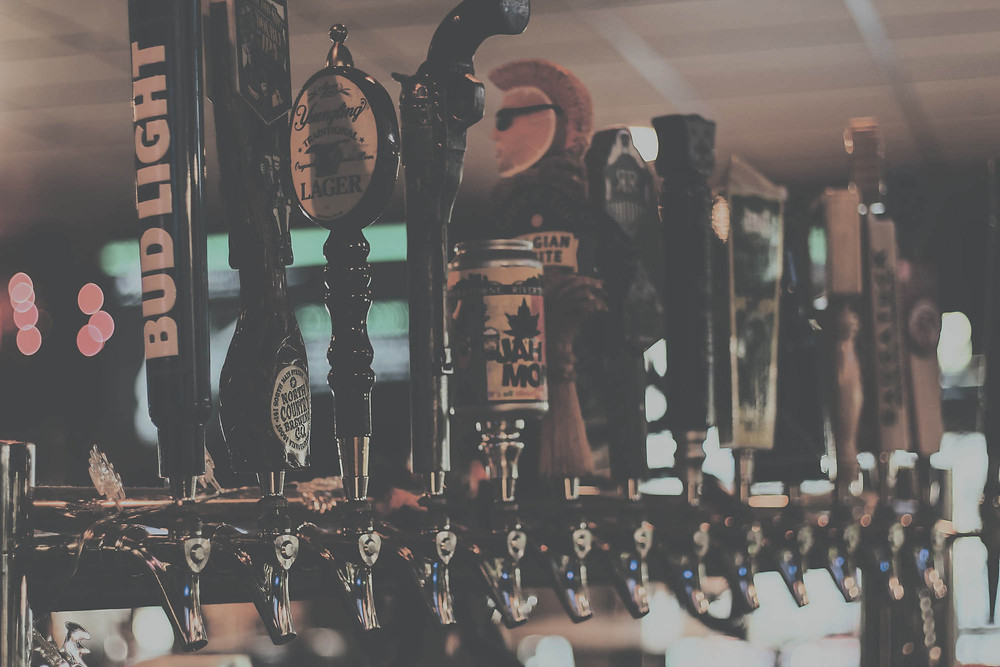 Taps of beer at Pub in the Park