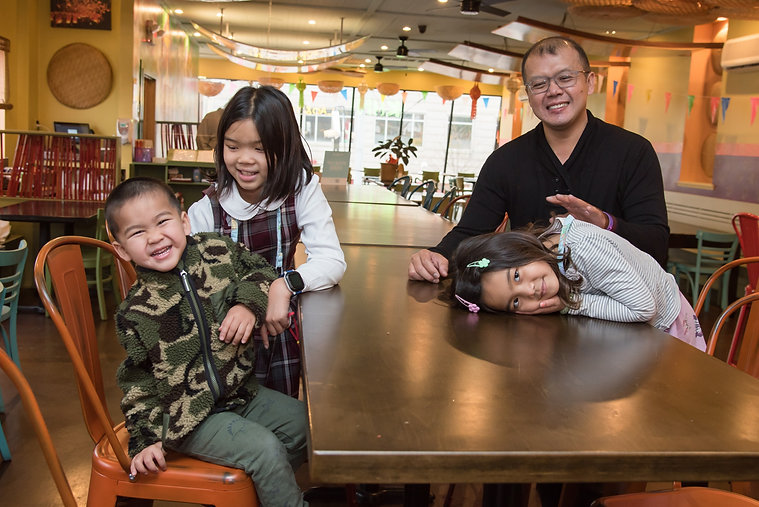 Restaurant owner Norraset Nareedokmai at Kiin Laos & Thai Eatery with his grandchildren in Pittsburgh, PA