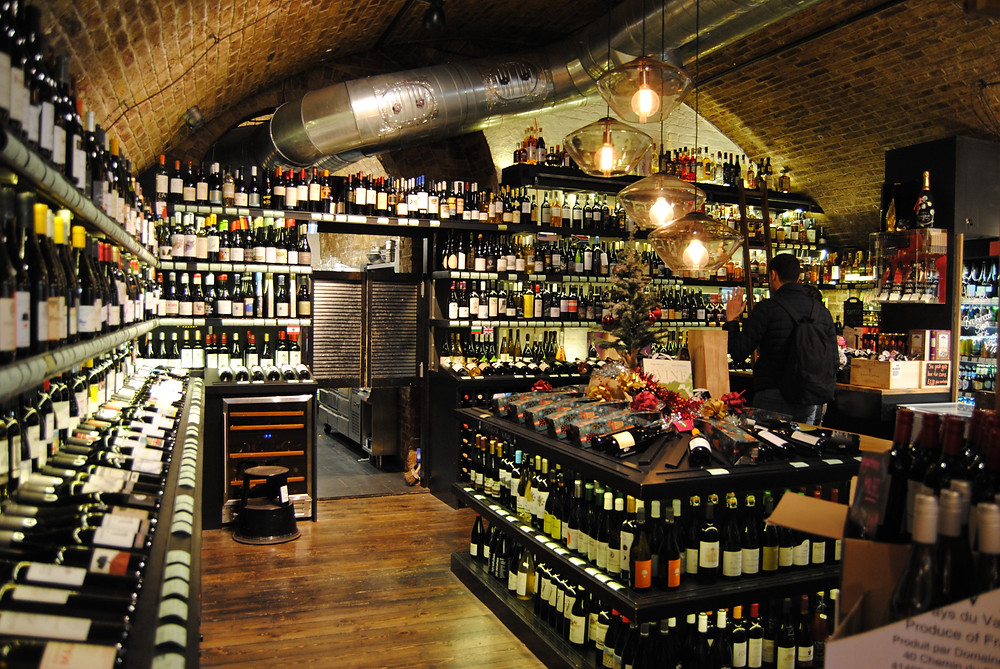 The wine room with brick arches
