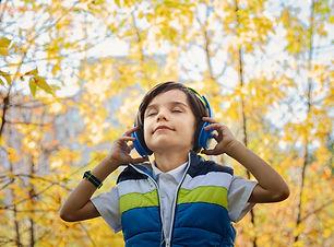 photo-of-a-boy-listening-in-headphones-1