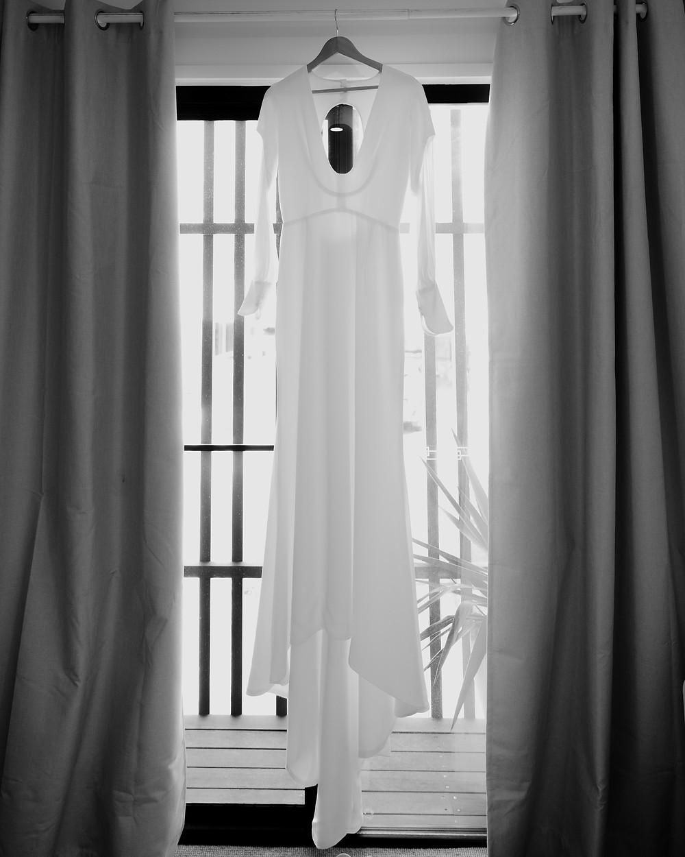 wedding dress in window of Byron Bay Air B'n'b in summer