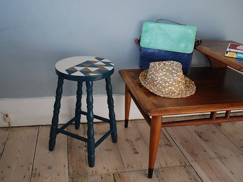 Geometric painted pattern wooden stool by Orange Otter