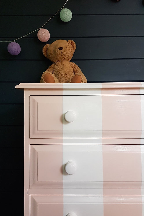 Pink and white striped chest of drawers by Orange Otter corner
