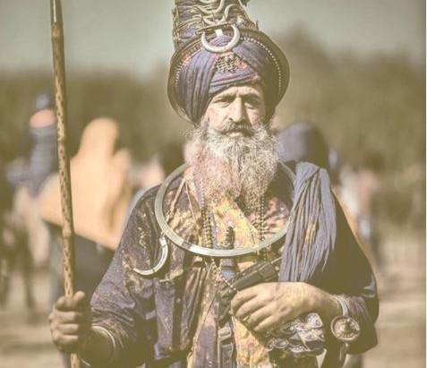 Guru Hargobind playing Holi - Suraj Prakash