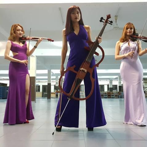 Malaysia Violinist Cellist Cello.JPG