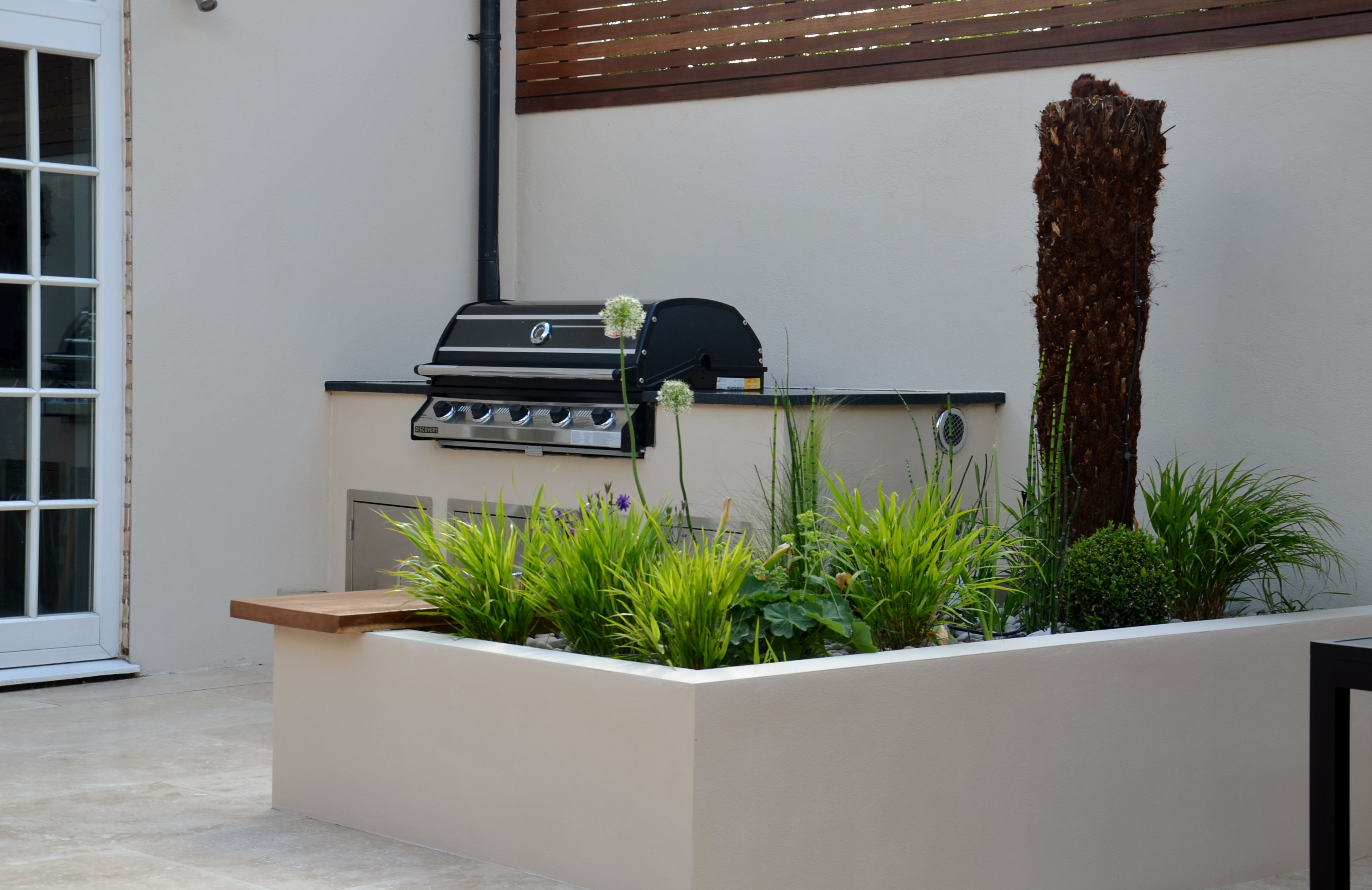 modern garden design outdoor room with kitchen seating  kew sutton