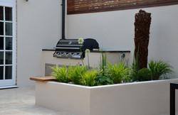 modern garden design outdoor room with kitchen seating  kew sutton