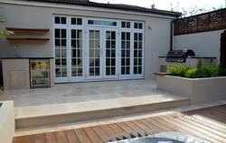 modern garden design outdoor room with kitchen seating epsom