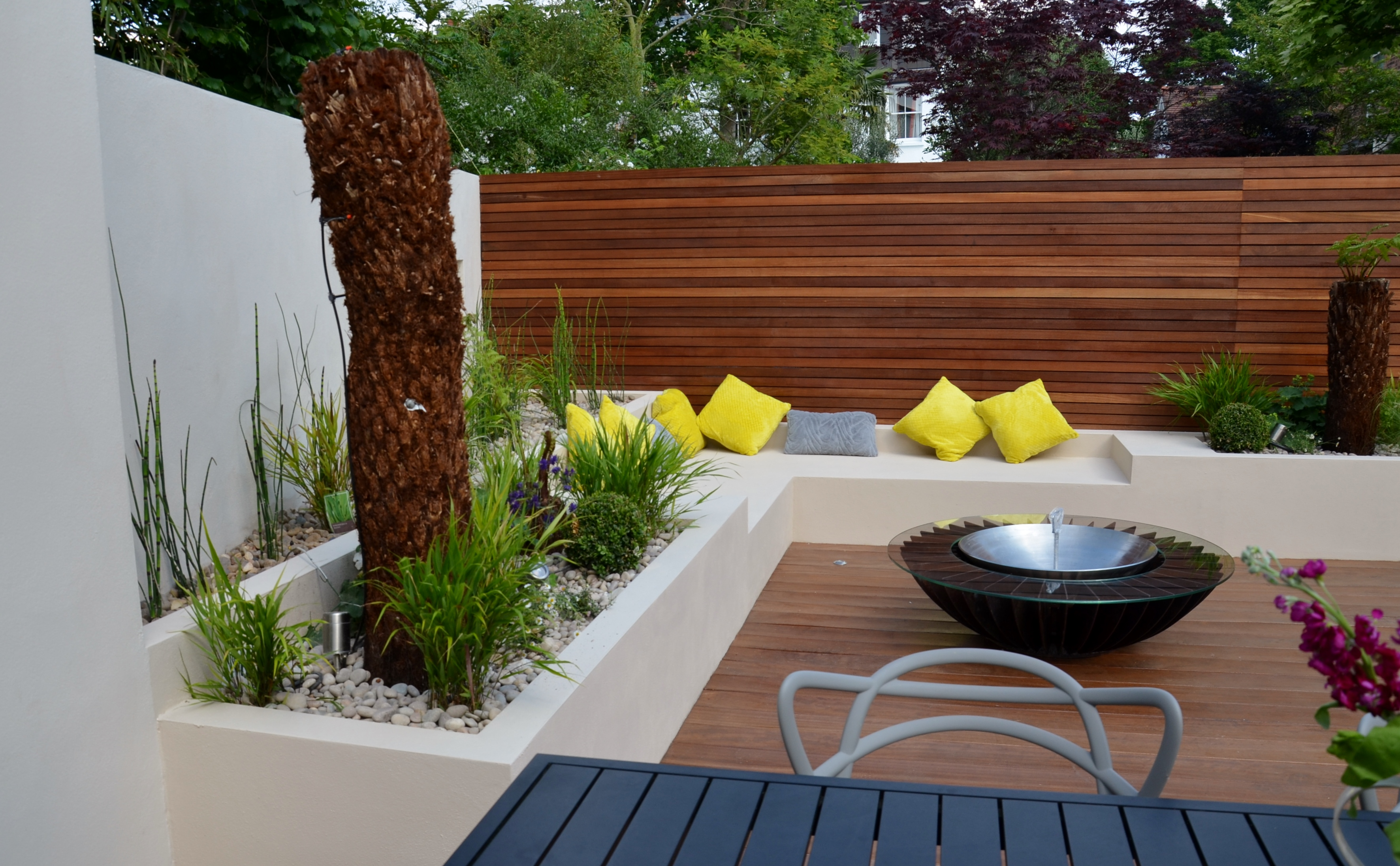 modern garden design outdoor room with kitchen seating  london
