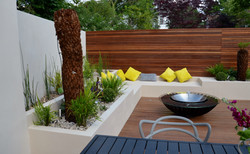 modern garden design outdoor room with kitchen seating  london