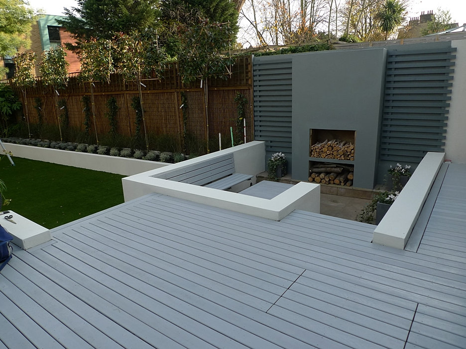 Modern Garden Design modern garden design ideas Grey Deck Sunken Chill Garden Area Flat Tree Hedge Raised Beds Fake Lawn Turf Grass London