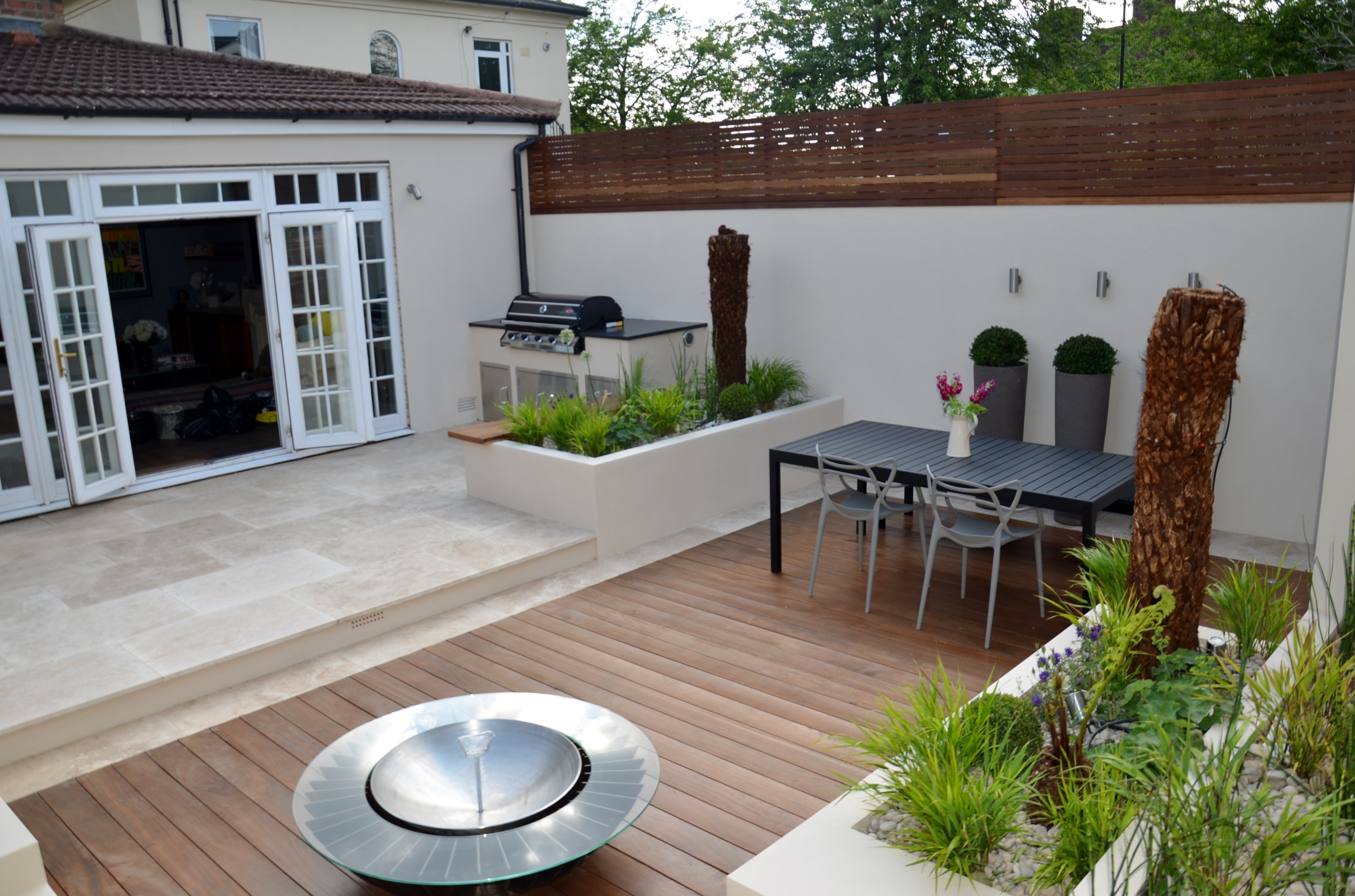 modern garden design outdoor room with kitchen seating  cheam richmond