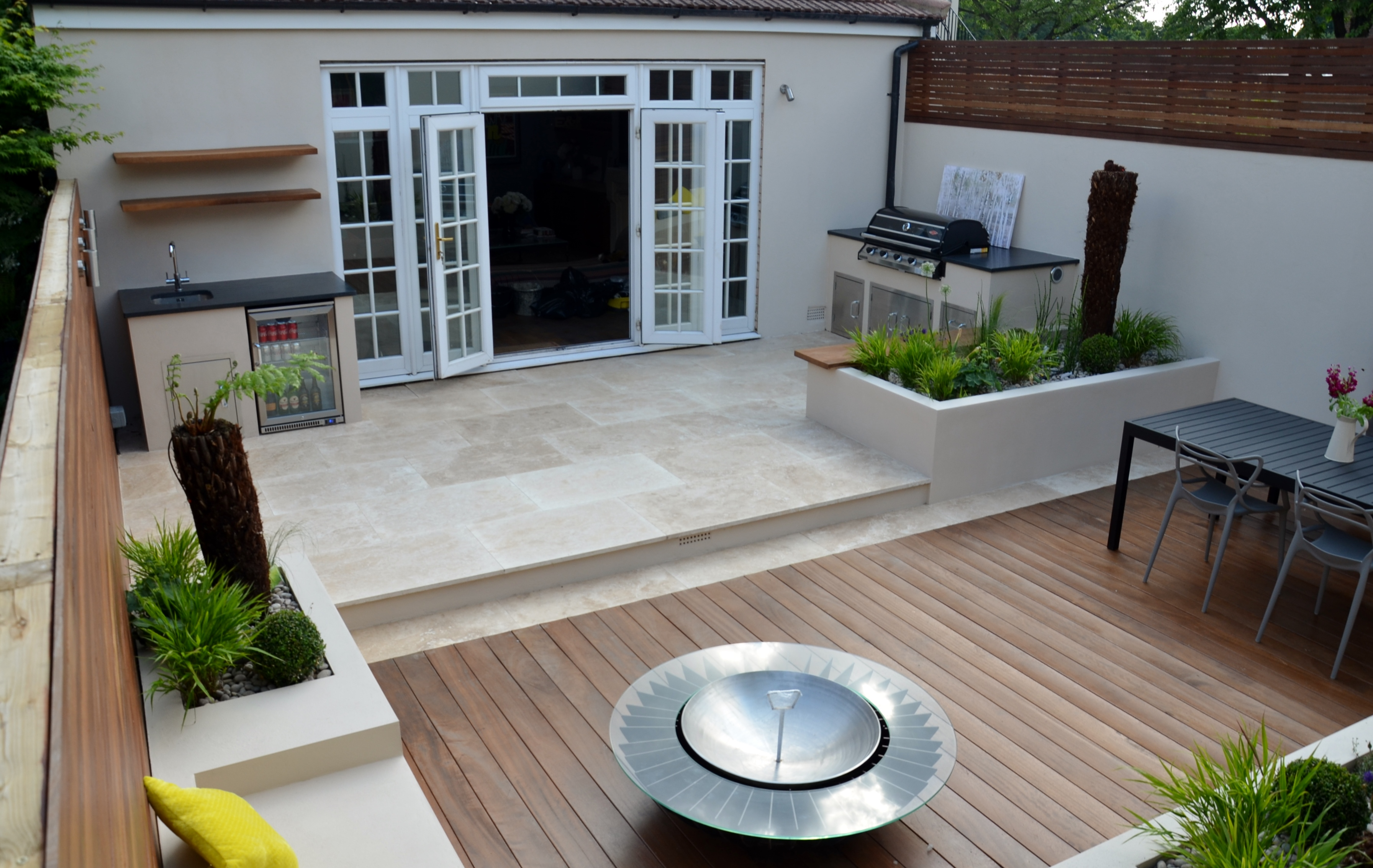 modern garden design outdoor room with kitchen seating  chiswick kew