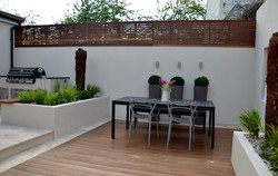 modern garden design outdoor room with kitchen seating  wimbledon