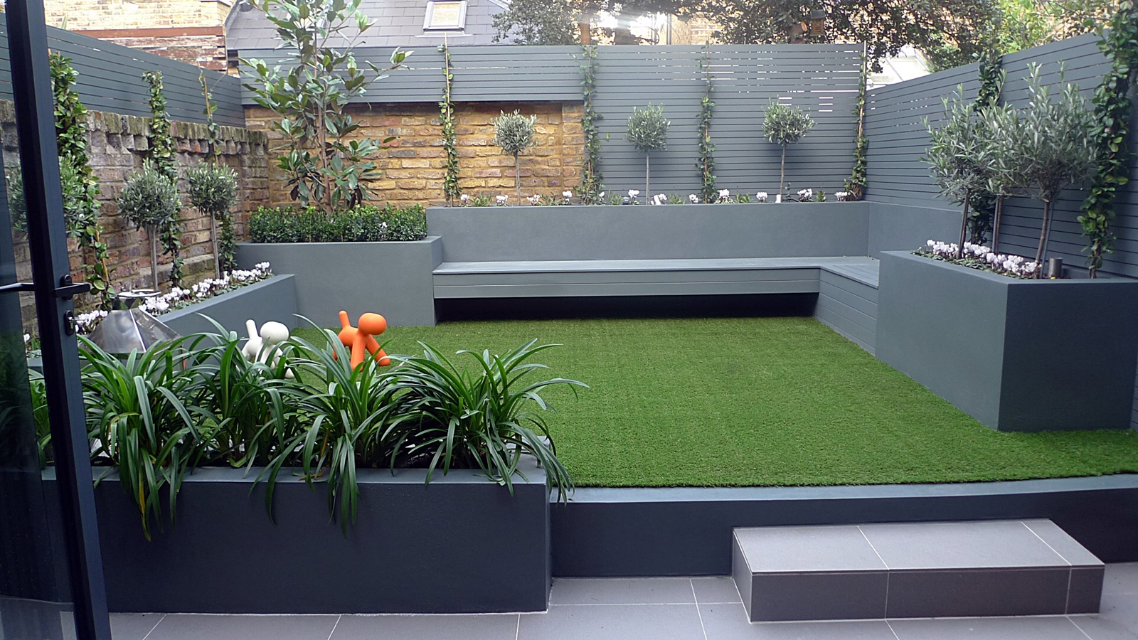 modern small garden design grey colour scheme raised beds floating bench easi grass lawn designer cl