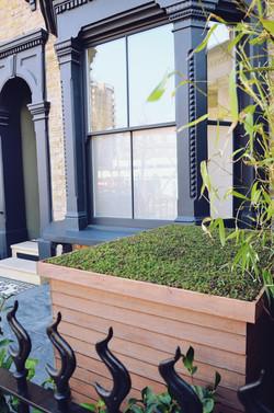 Victorian restoration with modern twist bin store living roof