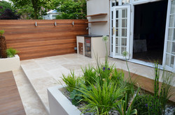modern garden design outdoor room with kitchen seating  wapping
