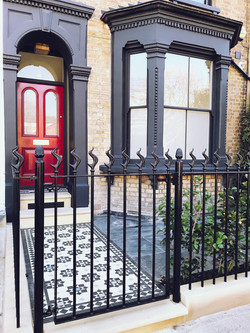 Victorian restoration with modern twist drilled rails and gate with flame finial