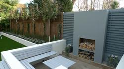 modern sleak garden low maintenance high impact garden design raised white wall beds grey decking ea