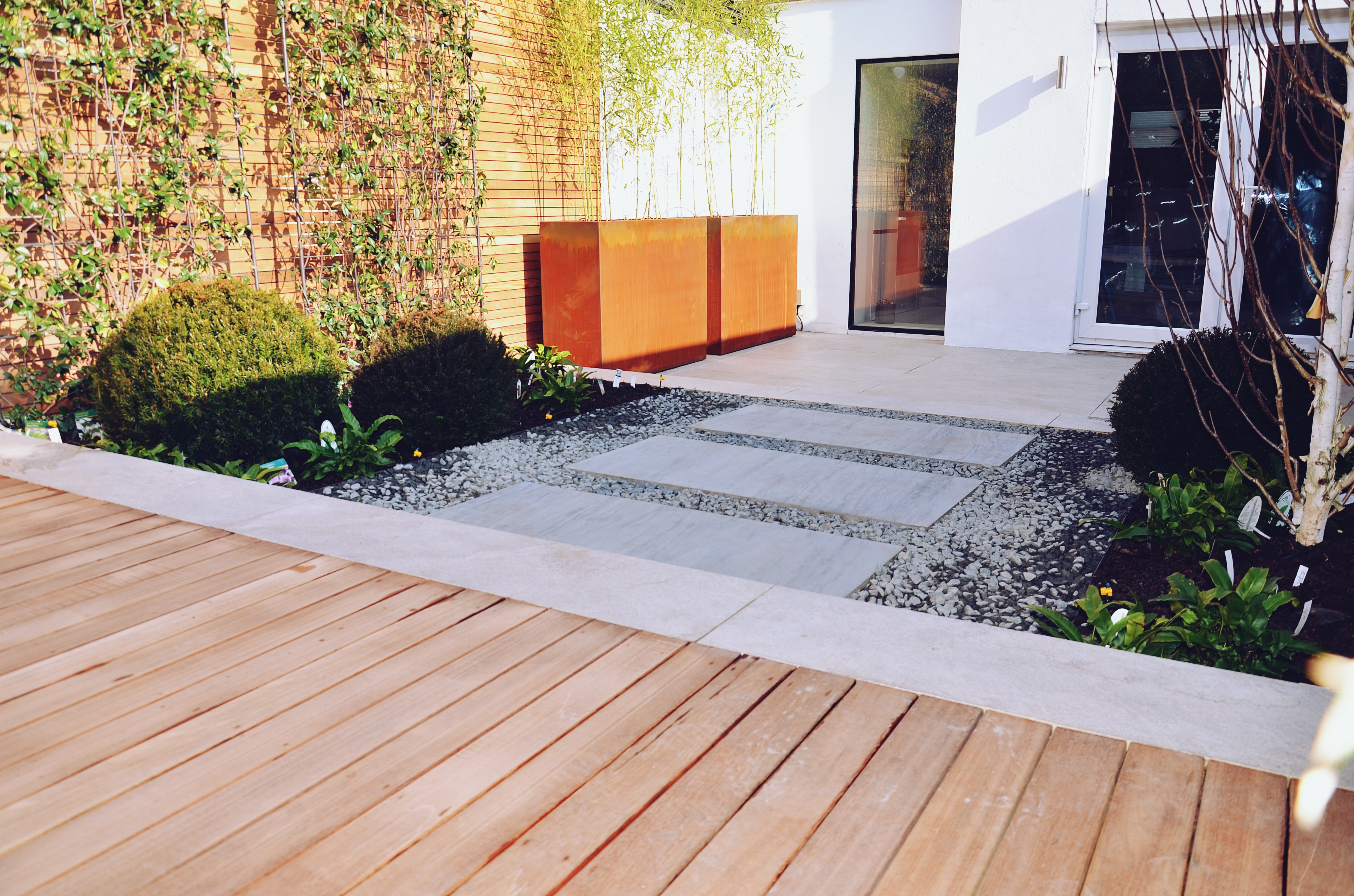 Garden builders Anewgarden Modern contemporary style London hardwood deck corten planter