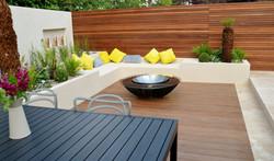 modern garden design outdoor room with kitchen seating  docklands
