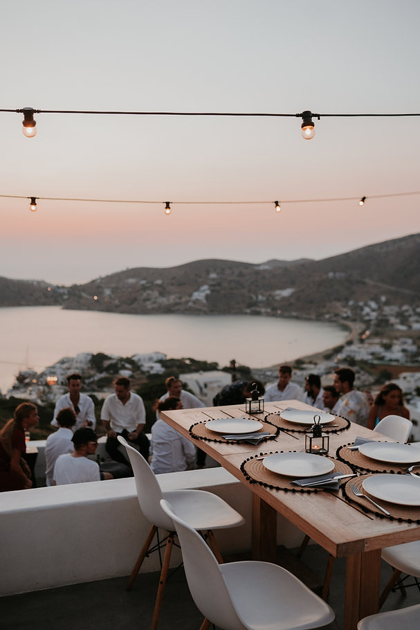 Wedding table setting with festoon lighting at sunset by The Isle