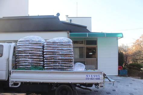 신동아건설 쌀 후원