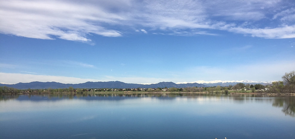 A lake with mountains in the background.