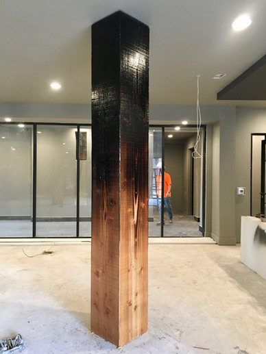 flame charred wood column