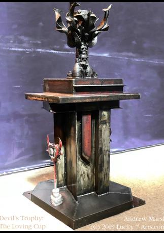 Devil's Trophy, by Andrew Marsh (C) 2018 Lucky 7 Arts, LLC