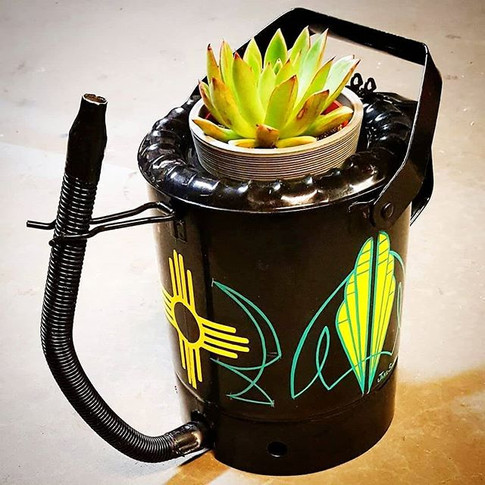 Old school oil can repurposed as a plant