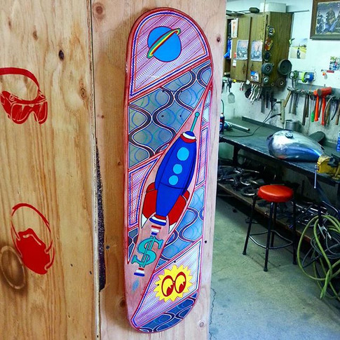 I found a spot at the shop to park my rocket ship skateboard for now.jpg