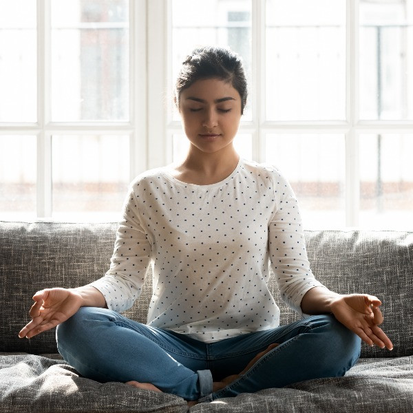girl meditating for self confidence