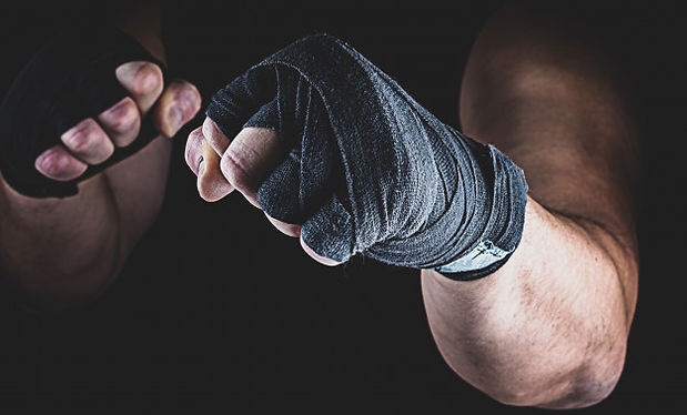 athlete-stands-fighting-stance_116441-26
