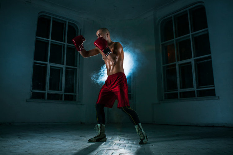 young-man-kickboxing-blue-smoke_155003-1