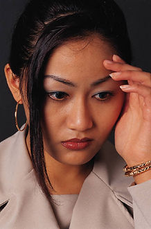 Image of a yong Asian woman symbolizing what depression feels like