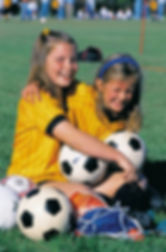 Image of two young girls preparing to play soccar
