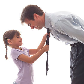 Image of a father bending forward so his daughter can help tie his tie
