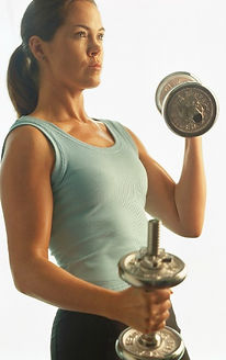 Image of young brunette woman lifting weights, symbolizing the importance of physical health