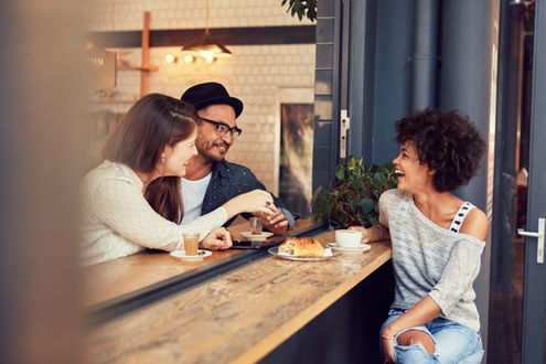 happy-young-friends-meeting-in-a-coffee-