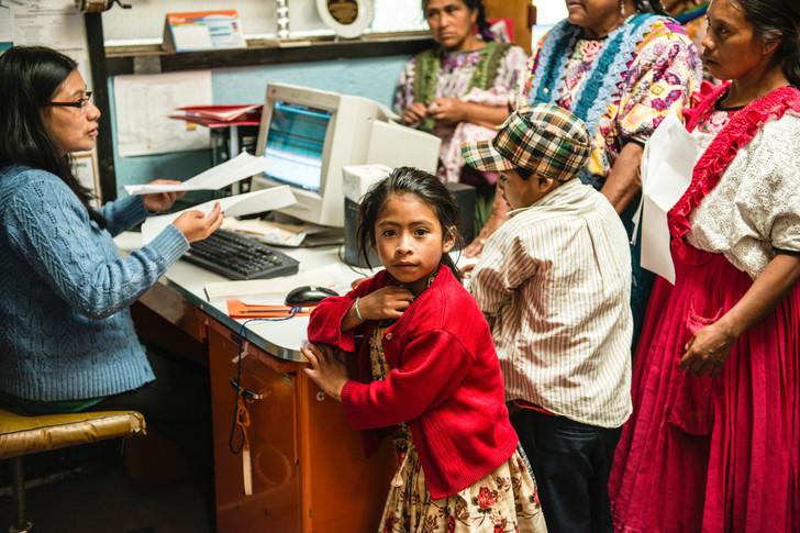 Patients registering at the primeros Pasos clinic.