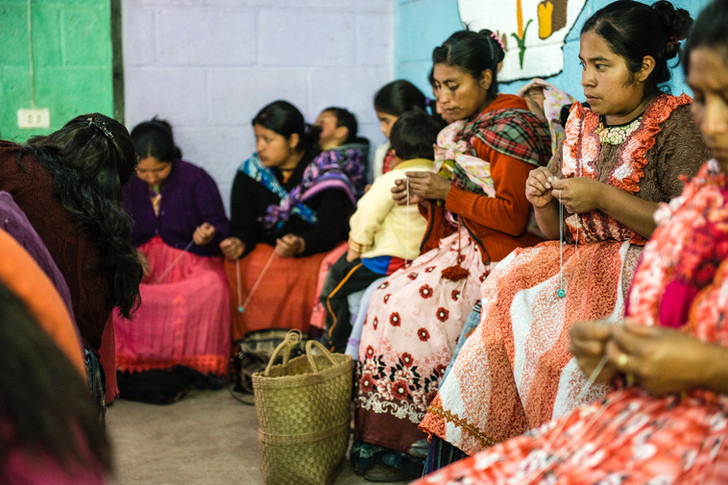 participants of the women's health education program at a meeting.