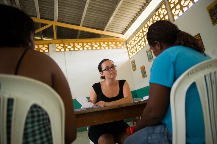 Rita giving personal legal consult at the church in San Lorenzo.