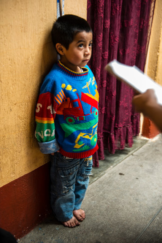 A child's height is being recorded to monitor the response to a nutrition program.