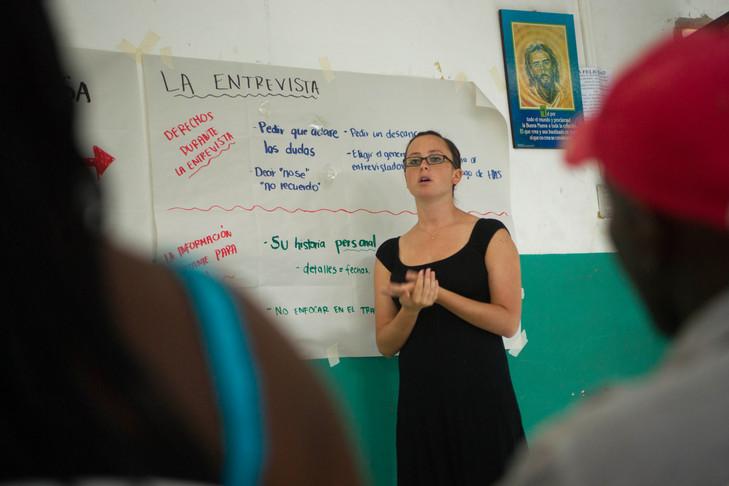 Rita explaining the process of applying for refugee status.
