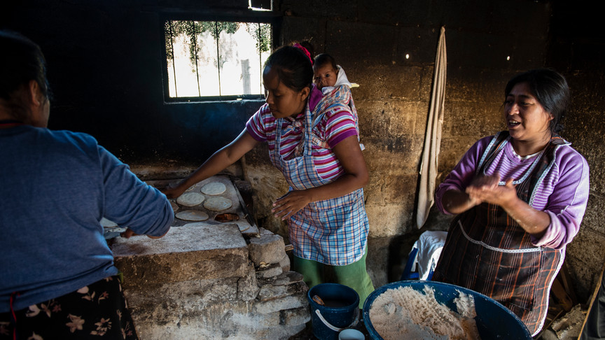 At the home of some of the school children. The women of the family support themselves by selling tortillas.
