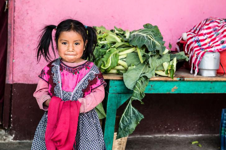A girl at a village day care. Primeros Pasos volunteers visit village daycares to identify malneurished children